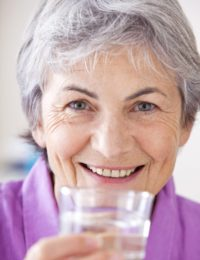 Grey Haired Woman With Glass