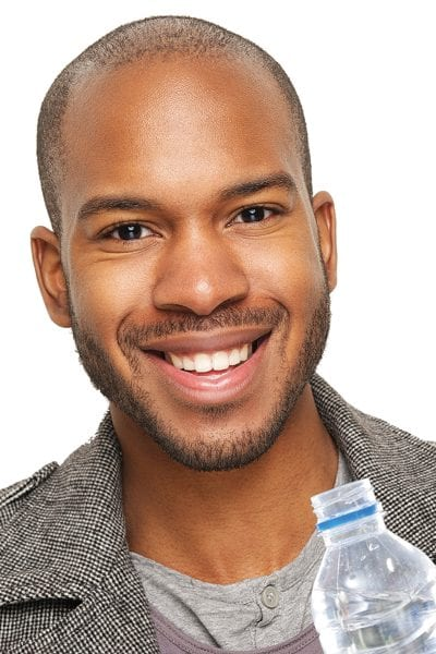 Handsome Dark Skinned Man With Bottle Of Water