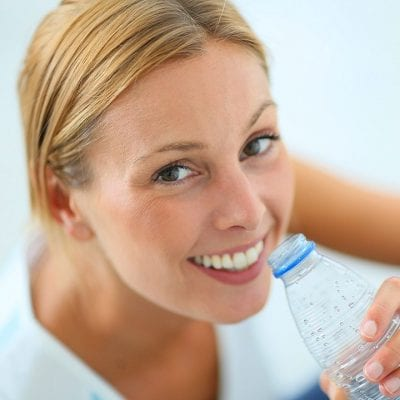 Blond Woman Drinking From Water Bottle